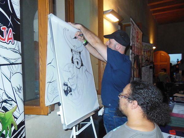 Mario Sciuto e William Calleja disegnano un poster durante il Dragon Fest 2018